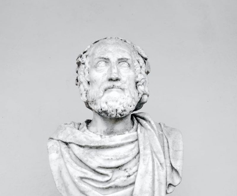 bust of ancient philosopher on grey background