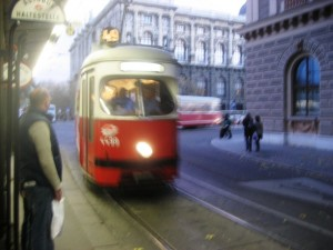 Tram 49 arriving at Dr Karl Renner Ring Station. Natural History Museum in the background.