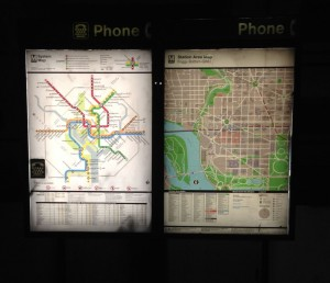 Washington Metro - backlit system and local area maps on telephone booth in station.