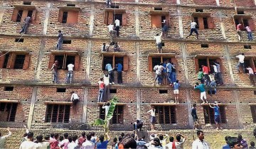 parents and friends of students scaling the walls of a 4-storey buildings and supplying cheat sheets to the students during their matriculation exams in Bihar