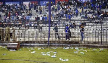 Water bottles thrown by spectators lie on the ground as the second Twenty20 cricket match between India and South Africa is disrupted in Cuttack, India, Monday, Oct. 5, 2015