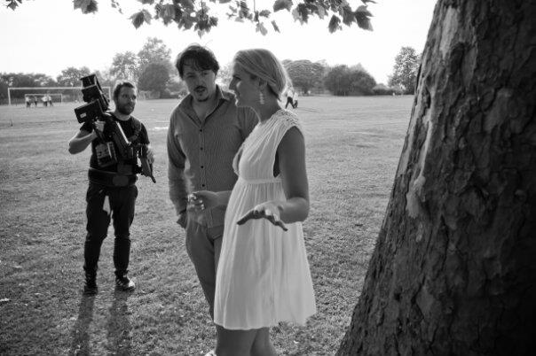 LETTERS TO VANESSA - Director Andy Wooding and actress Ali Currey talk on set as Cinematographer Paul Thomson rests