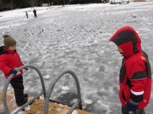 walking on frozen whistler lake with kids