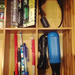utlity drawer for winter cabin with lip balm, multifunction screwdriver and camera cord