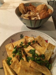 baked tofu topped with soy sauce, lime, ginger and green onions