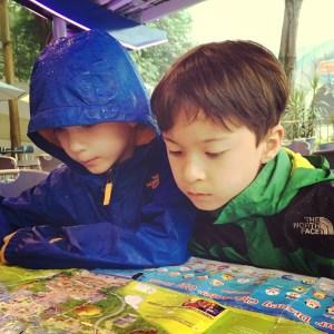 Hong Kong Disneyland with kids in an amber rainstorm