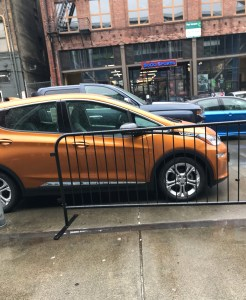 Orange Chevy Bolt electric car outside Seattle Auto Show
