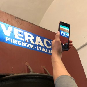 Using Google Translate in Italy to instantly translate Italian into English using a smartphone