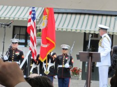 American armed forces usher in the flag.