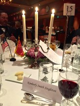 """The pretty table settings, complete with a commemorative """"Bloodaxe"""" mug. (Each year, the guards get to pick a mug motif, so this year they went Norwegian.)"""