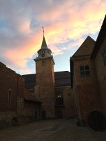 The castle courtyard in late afternoon, with a view of the Blue Tower.
