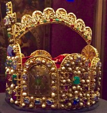 """""""Charlemagne's Crown"""" has eight sides symbolizing the eight gates to Jerusalem. Seed pearls on this side of the arch read: Romanoru (M) Imperator Aug(ustus), """"Emperor of the Romans (and) Augustus."""" On the other side it says: Chuonradus Dei Gratia"""" Conrad, by the Grace of God."""" (Conrad was the ruler after Otto.) The little cloisonné guy is King Solomon, who symbolizes royal wisdom."""