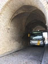 Yep, even city buses barrel through the old gateway.