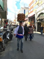 """This guy is carrying a load of """"simit"""" (Turkish bagels) to his street cart. Covered with sesame seeds, these treats are a traditional breakfast food."""
