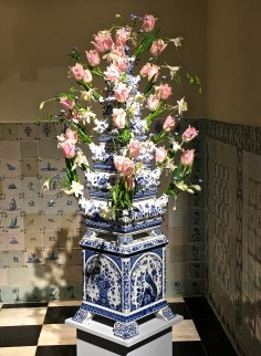 The Dutch copied Chinese porcelain painting techniques, but put their own spin on it by creating these tulip pyramids. Later, the Chinese made cheap copies, which the Dutch East India Company then imported. So it's kind of like a copy of a copy of a copy. This tulip pyramid is almost as tall as I am. It comes apart in sections for shipping and storage, which makes it easy to pour water into each segment without springing a leak out the openings.