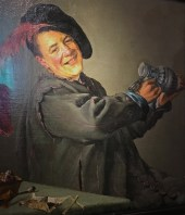 """Pictured is Frans Hals' version of the hard-drinking and smoking, """"Peeckelhaering"""" (Pickled Haring), a comic figure that entertained kids and adults at fairs. His merry tippling allowed him to get away with mocking and making fun of others' weaknesses, like drinking and smoking too much -- note the smokes on the table. (We'd call him a jester today.) Hals went on to paint several versions of this character, one of his favorite subjects."""