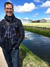 Matthew stands next to one of the canals that keep the sandy soil well drained. Too much water is the enemy of a healthy bulb.