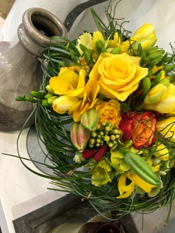 """Check out the woven nest of Bear Grass used to create the bouquet holder for this bundle of blossoms. A panel of expert judges awards prizes not only for the best arrangement, but also for the """"Best in Breed."""""""