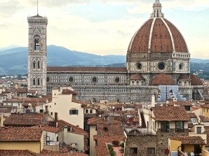 """Construction on Florence's Duomo (meaning """"cathedral"""") began in the 1296. Officially known as the Cathedral di Santa Maria del Fiore, it has the third longest nave (153 meters / 502 feet) in Christendom. I'd hate to have to walk that distance as a bride. Wonder how many girls passed out before they made it to the altar?"""