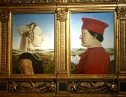 """Piero della Francesca, geometrician and master of perspective, painted this pair of portraits. They depict the Duke and Duchess of Urbino -- he's one of the leaders who inspired Machiavelli's work, Il Principe. The Duke is always portrayed on his """"good side;"""" he had acquired a huge scar and lost an eye in a tournament. Possessing only one eye hampered the Duke's aim, so he had surgeons carve away the bridge of his nose to improve his field of vision. His wife, who he described as """"the delight of my public and private hours,"""" died at age 25 after the birth of their seventh child. Considered a beauty, she had bleached hair and a plucked hairline to raise her forehead. Her white skin reflects the fact that the portrait was done post mortem."""