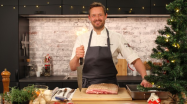 """As part of the """"Kvelden før Kvelden,"""" food enthusiast Jørn Hoel and TV chef Øyvind Hjelle showed folks how to make """"ribbe"""" -- it's roasted pork belly. And it's one of three traditional Norwegian Christmas dishes, along with lutefisk (fish preserved in lye) and pinnekjøtt (mutton ribs that have been cured, dried, smoked, then reconstituted and steamed over birch sticks.)"""
