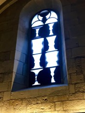 You can see how his photographic techniques of combining negatives with positive prints influenced his designs. This window reminds me of those old brain teasers where you had to say whether you saw a vase, or two people talking.