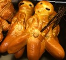 """These are Grittibänzen, commonly called """"Bread Men,"""" which make an appearance at Christmas time. I think these are supposed to represent Schmutzli, the Swiss Santa's sinister sidekick, who carries a bundle of twigs that he uses to beat bad children. (Schmutzli is another pagan holdover that represents an evil demon who stole children and was driven out by noise and light during the solstice. Not so different from the Norwegian Lussi traditions I wrote about in my post """"Santa Lucia Day."""")"""