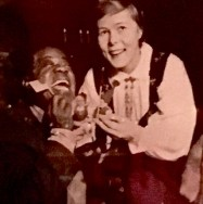 Satchmo seems to have taken a fancy to Gerd's dolls dressed in Norwegian traditional costumes. It looks like he's even gifting them with an American flag.