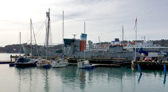 """Across from the Kokeriet sits the """"Southern Actor,"""" a whaling ship (now a museum) that highlights Sandefjord's history as the center of Norwegian whaling until 1968, when the industry began to dry up."""