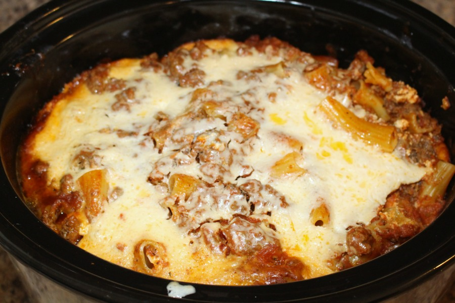 This simple and delicious Slow Cooker Baked Ziti recipe is the perfect dinner recipe any night of the week. It's even great for parties! The pasta cooks right in the sauce for less prep time!