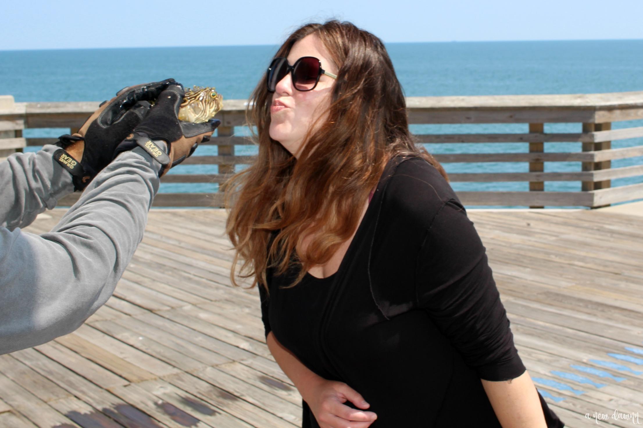 Woman looking at a fish in Nags Head, NC