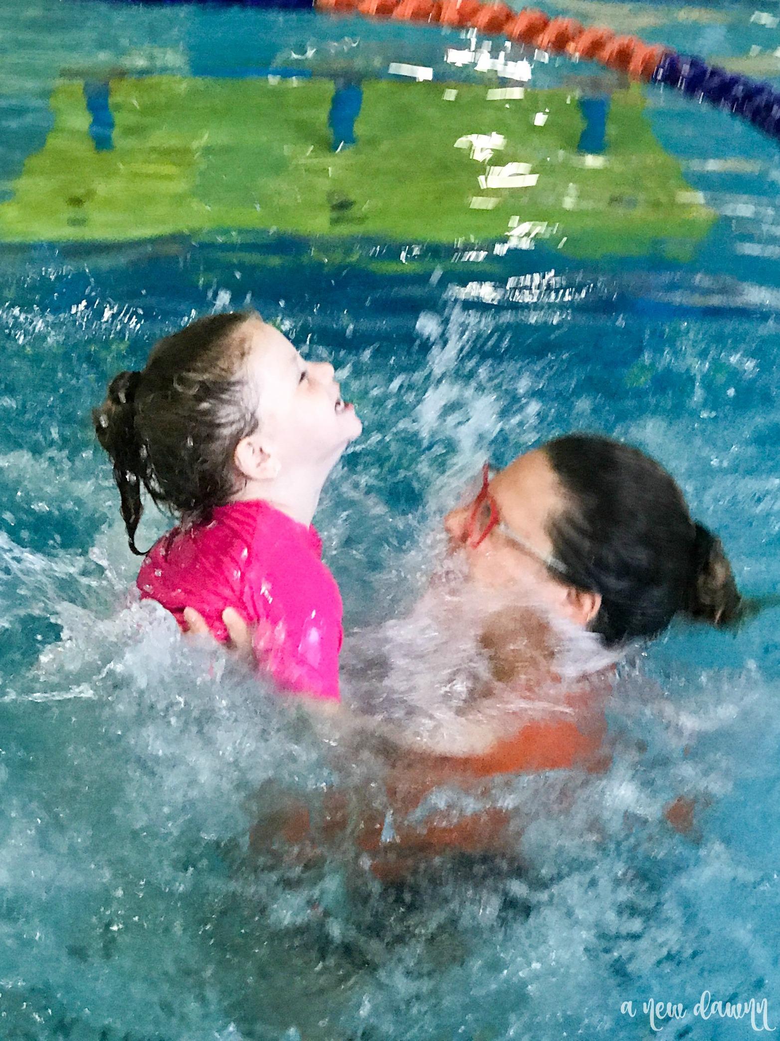 Splashing in the pool at Goldfish Swim School