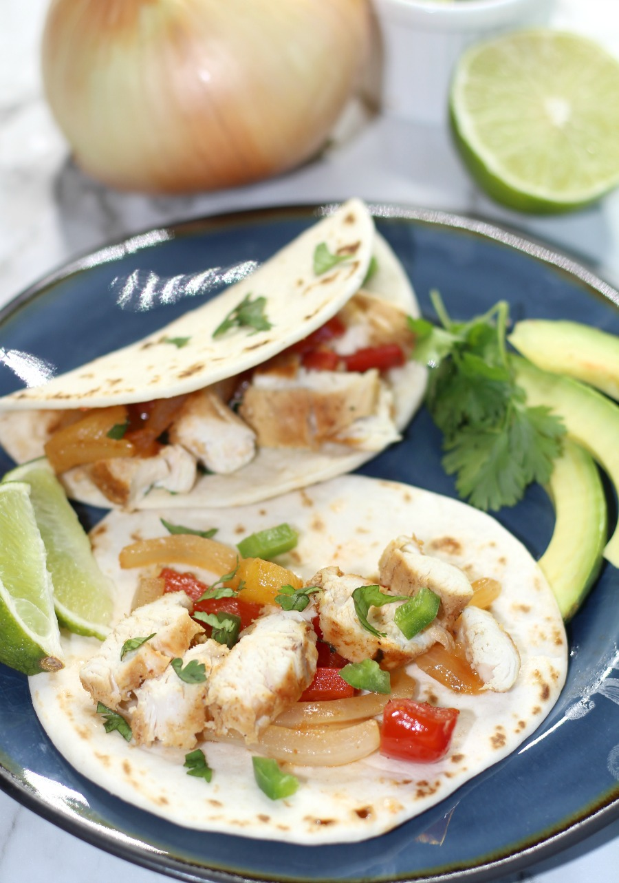 Hawaiian Chicken Skillet Tacos take Taco Tuesday to the next level! Juicy chicken marinated in a delicious sauce make these the best chicken tacos you'll ever have!