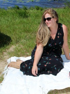 woman sitting on blanket in park