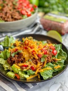 taco salad on a black plate