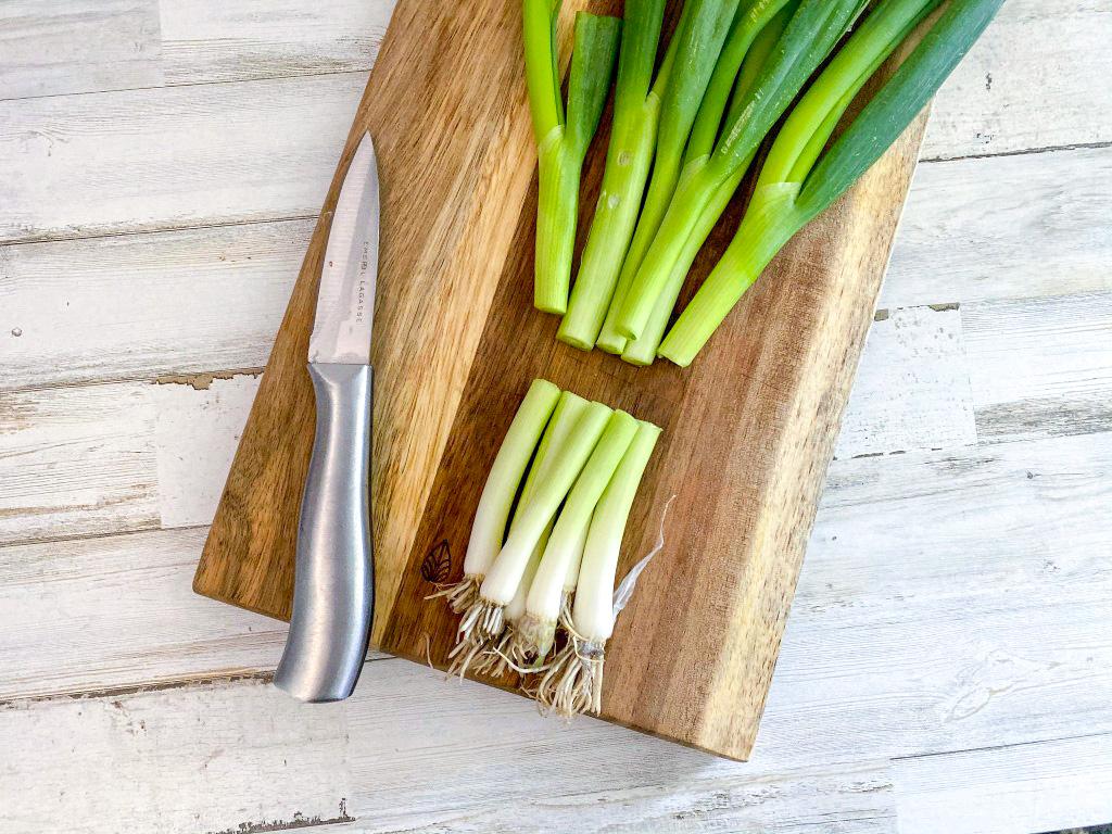 cut green onions on a cutting board