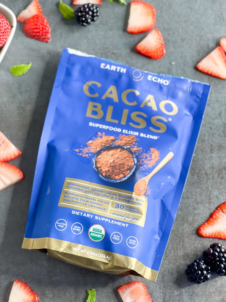 a bag of cacao bliss on table with fruit around