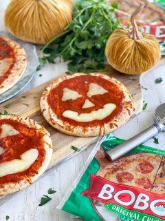 halloween pizza on a table