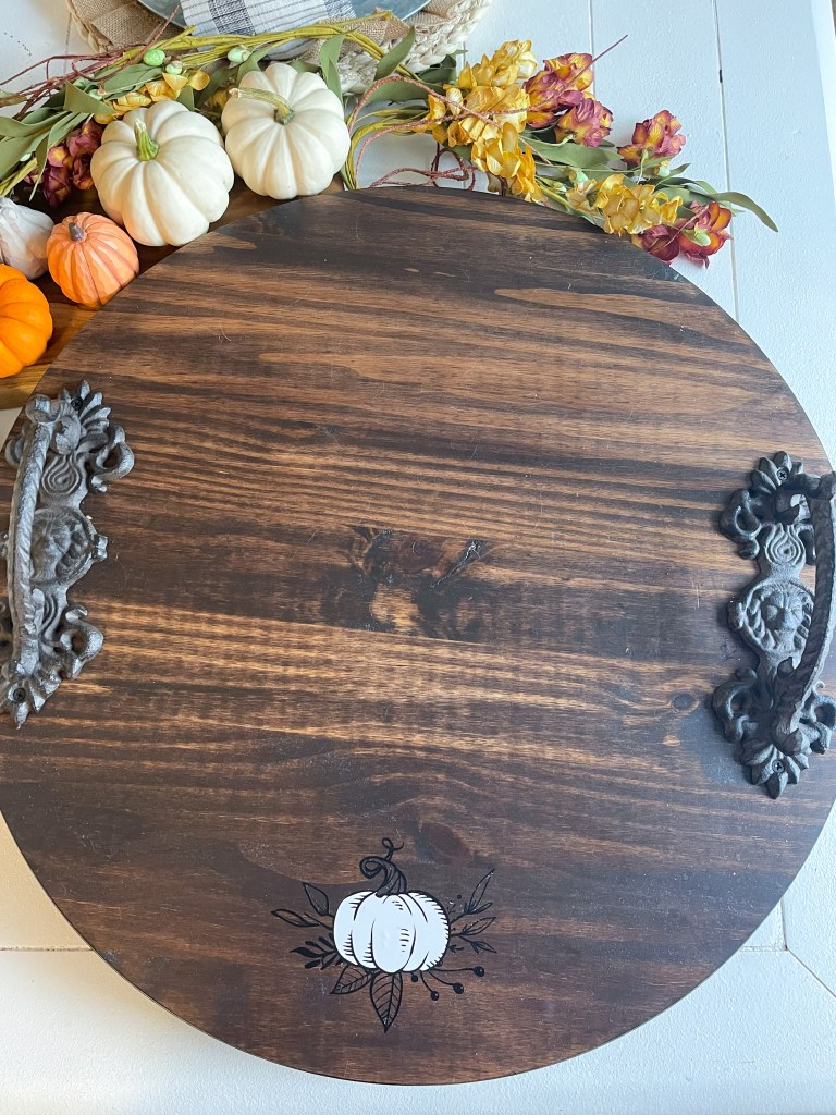 Charcuterie board customized with pumpkin made with Cricut