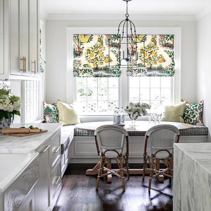 Means + Carney INTERIORS Kitchen with Schumacher Citrus Garden Roman shades and pillows
