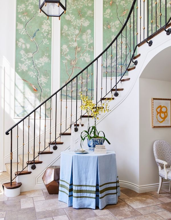 Mark D. Sikes entryway with Chinoiserie panels and a skirted table