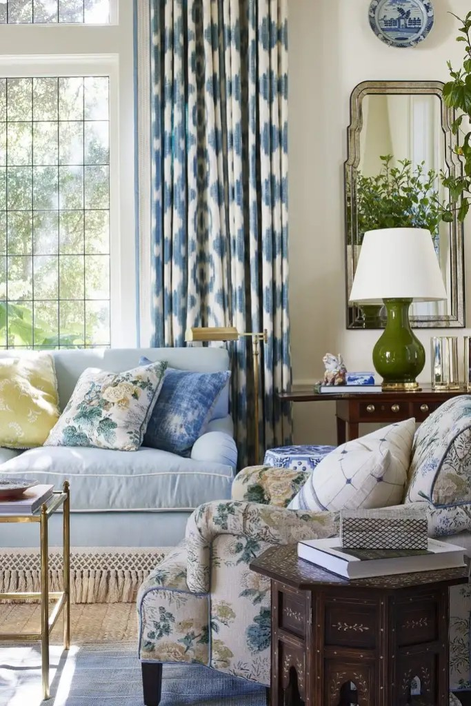 Mark D. Sikes living room with blue couch and Althea pillow