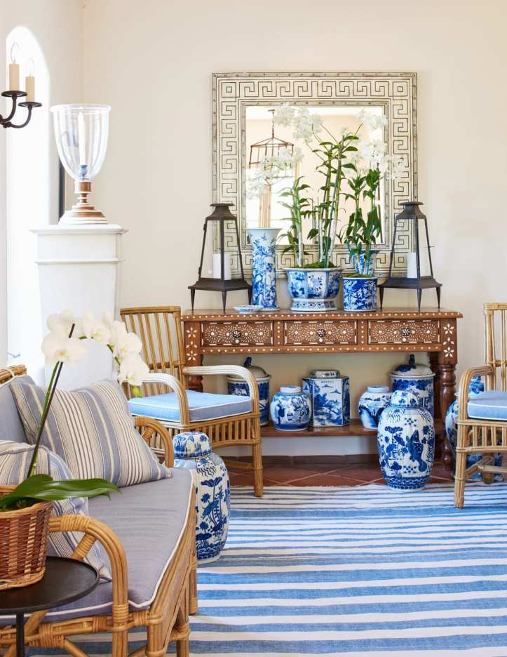 Mark D. Sikes entryway with wicker furniture and blue stripe rug