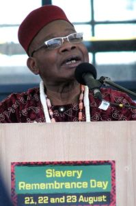 Chief Angus Chukwuemeka presides over traditional West African libation ceremony at Pier Head