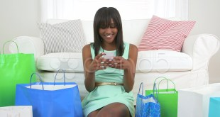 black-woman-shopping-bags-texting-footage