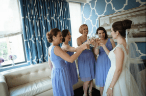 Katie with her bridesmaids toasting to the start of a wonderful day - Photo by Joe Foley Photography