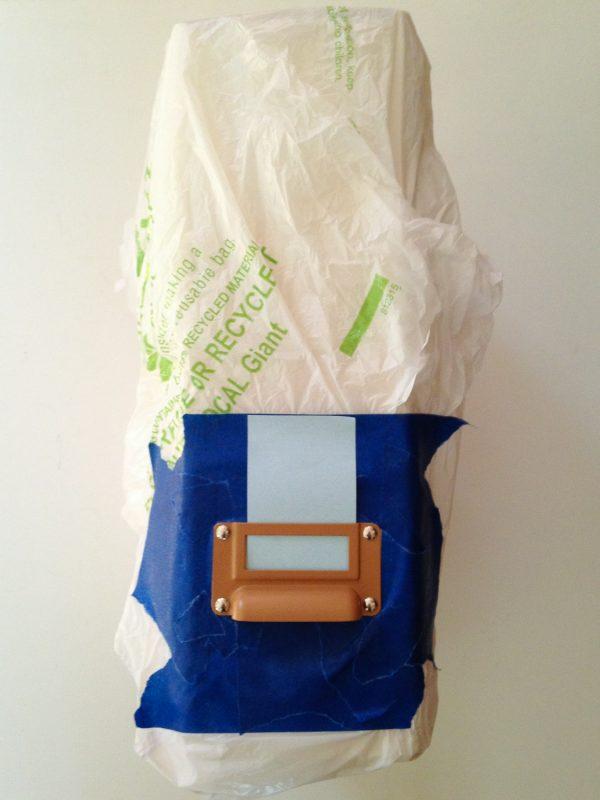 Preparing IKEA magazine holder for spray paint