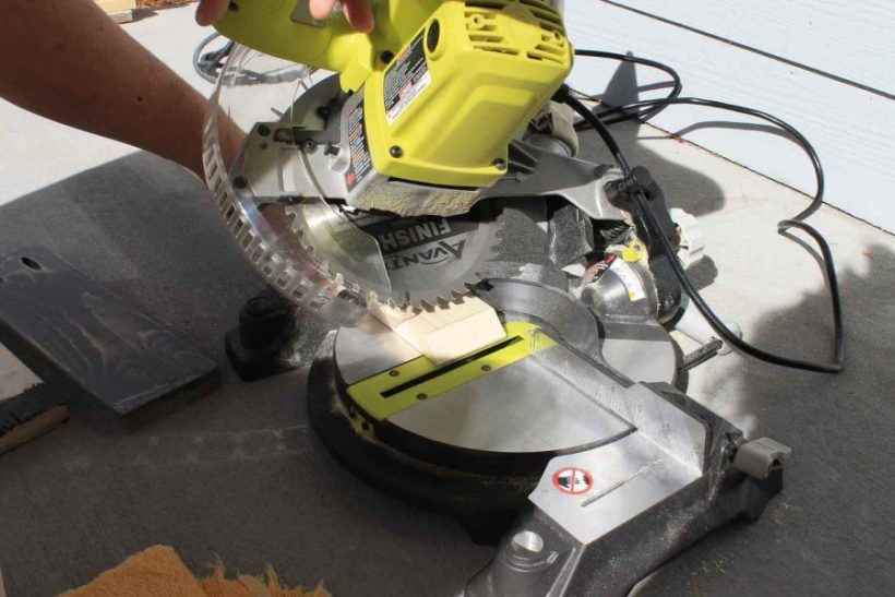 cutting side wood pieces with miter saw
