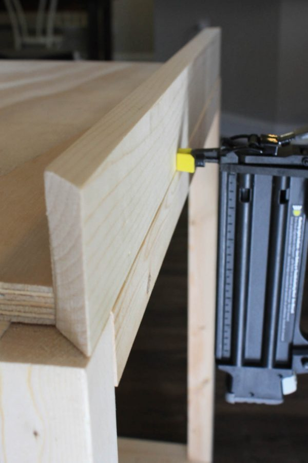 Attaching corners of bar cart with brad nails
