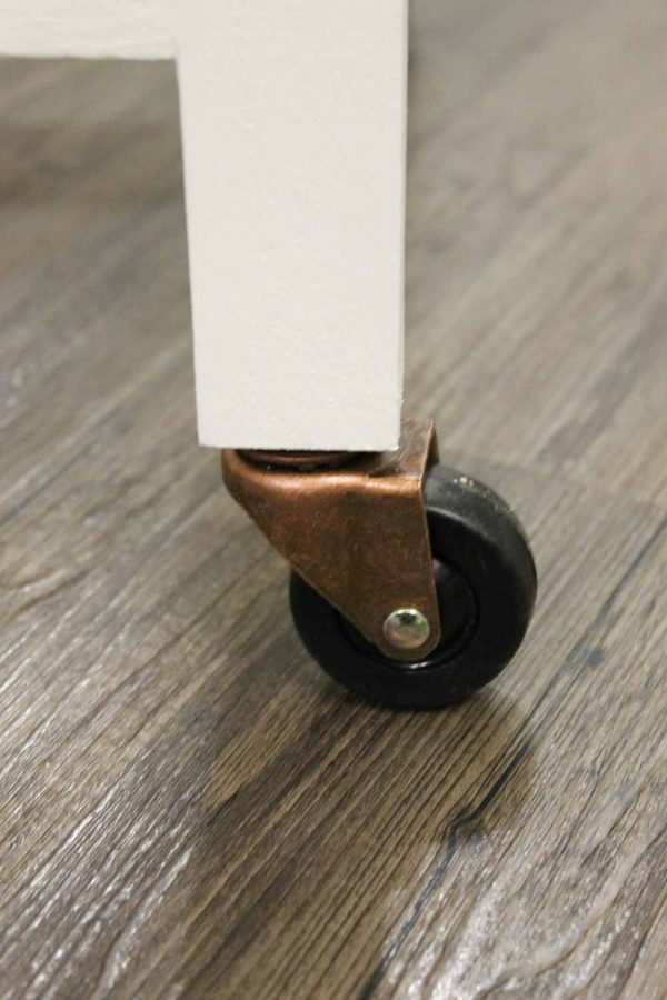 caster wheels attached to bottom of bar cart